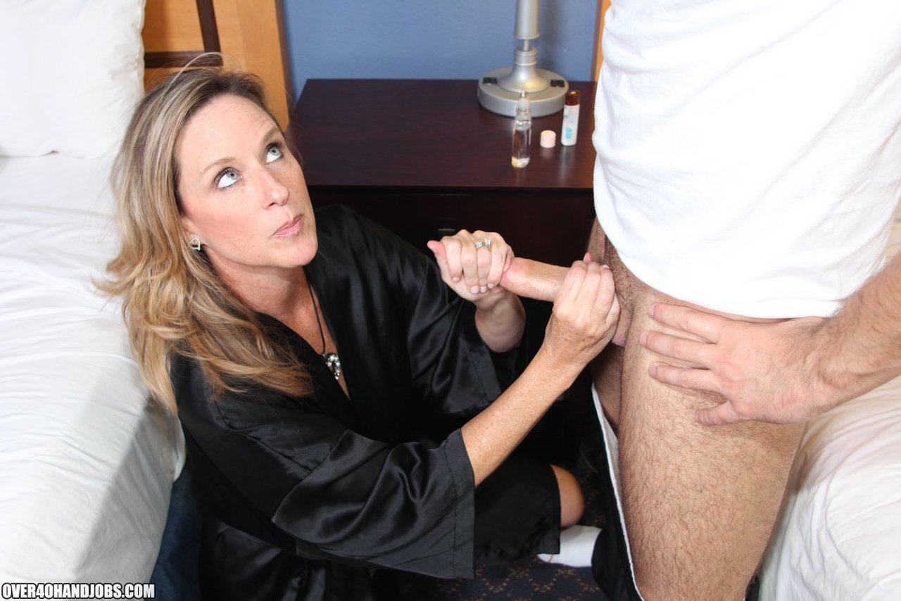 Middle older blond Jodi West milks off..
