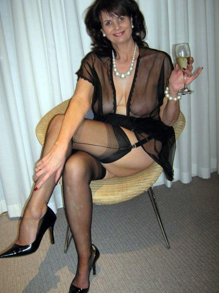 Sexpot mature women posing at home in..