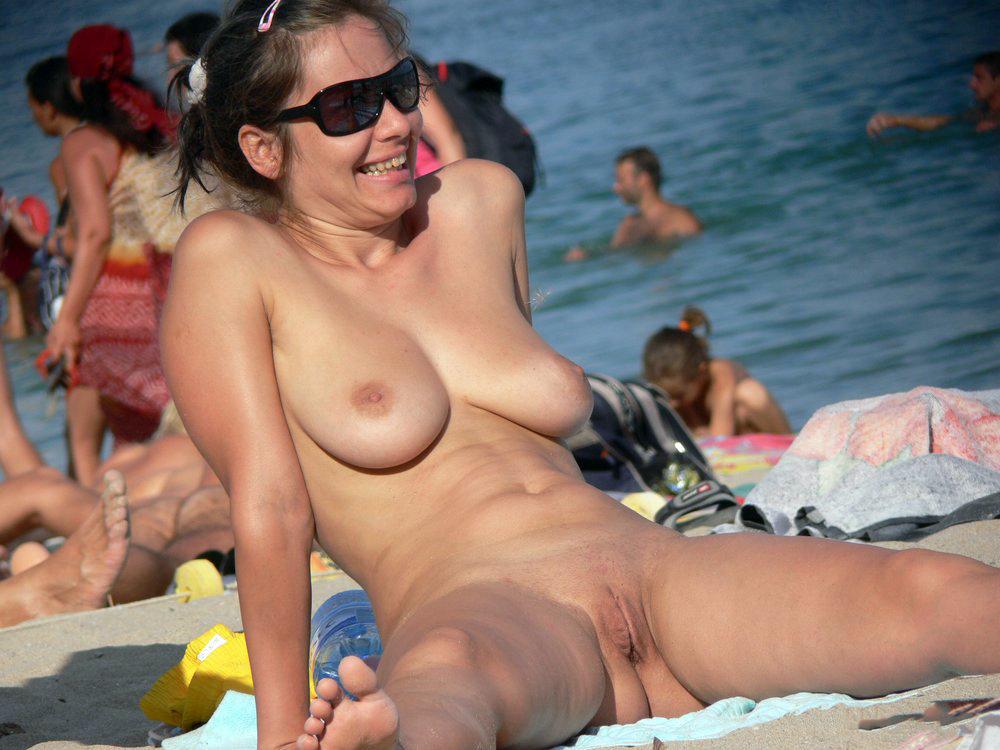 Naturist and nudist women stretching..