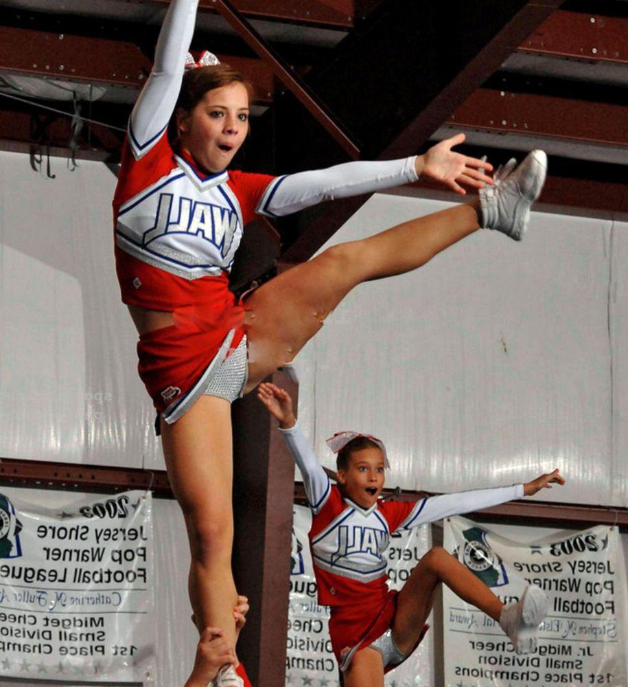 Little girls cheerleaders during..