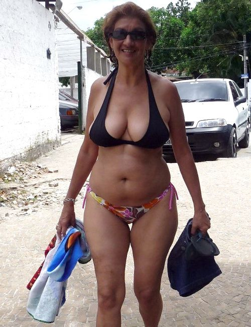 Dissolute granny sunbathing bare on..