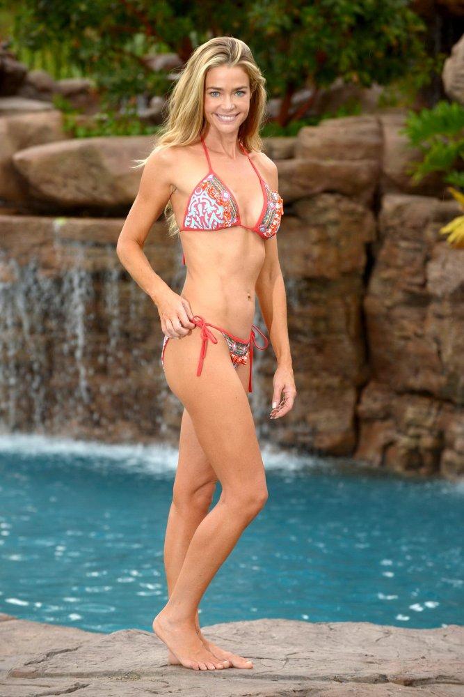 Denise Richards in swimsuit posing..